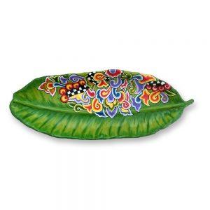 ausgefallene schale in form eines bananenblattes, grün mit extravagantem muster