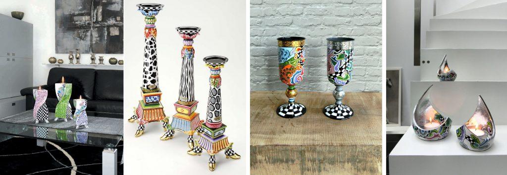 bunte Kerzenhalter auf Tisch, bunte Vasen auf Holz